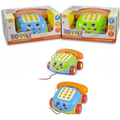 Baby telefon s obličejem tahací na baterie se šňůrkou na kolečkách plast 2 barvy Zvuk